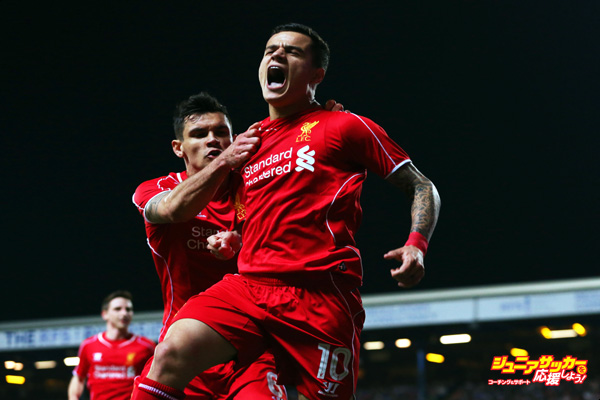 BLACKBURN, ENGLAND - APRIL 08:  Philippe Coutinho of Liverpool (10) celebrates with Dejan Lovren as he scores their first goal during the FA Cup Quarter Final Replay match between Blackburn Rovers and Liverpool at Ewood Park on April 8, 2015 in Blackburn, England.  (Photo by Jan Kruger/Getty Images)