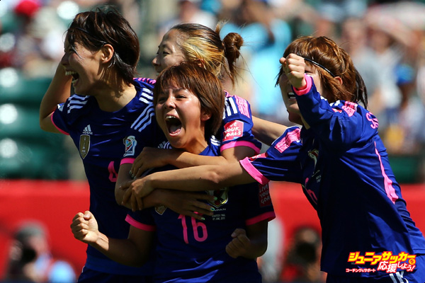 EDMONTON, AB - JUNE 27:  Mana Iwabuchi #16 of Japan celebrates with teammates after scoring a goal during the FIFA Women's World Cup Canada 2015 quarter final match between Japan and Australia at Commonwealth Stadium on June 27, 2015 in Edmonton, Alberta, Canada.  (Photo by Maddie Meyer - FIFA/FIFA via Getty Images)