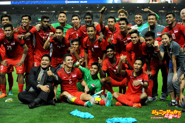 SAITAMA, JAPAN - JUNE 16:  Singapore players celebrate after the 2018 FIFA World Cup Asian Qualifier second round match between Japan and Singapore at Saitama Stadium on June 16, 2015 in Saitama, Japan.  (Photo by Masashi Hara/Getty Images)