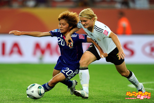 WOLFSBURG, GERMANY - JULY 09:  Mana Iwabuchi of Japan battles with Saskia Bartusiak of Germany during the FIFA Women's World Cup 2011 Quarter Final match between Germany and Japan at Arena IM Allerpark on July 9, 2011 in Wolfsburg, Germany.  (Photo by Mike Hewitt - FIFA/FIFA via Getty Images)