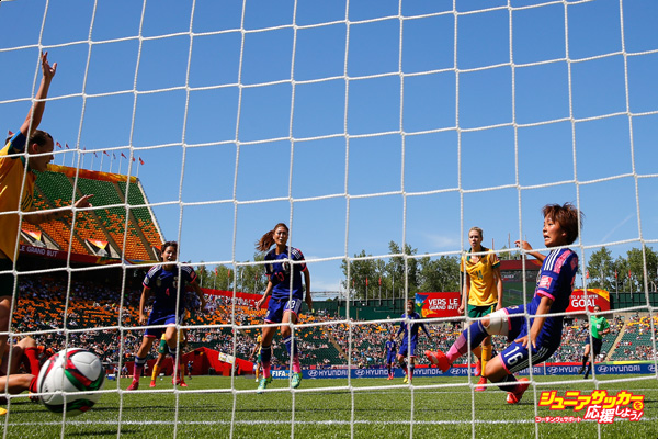 EDMONTON, AB - JUNE 27:  Mana Iwabuchi #16 of Japan scores their first goal against Australia during the FIFA Women's World Cup Canada 2015 Quarter Final match between Australia and Japan at Commonwealth Stadium on June 27, 2015 in Edmonton, Canada.  (Photo by Kevin C. Cox/Getty Images)