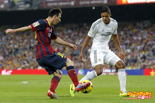BARCELONA, SPAIN - OCTOBER 26: Lionel Messi of FC Barcelona is challenged by Raphael Varane of Real Madrid during the La Liga match between FC Barcelona and Real Madrid at Camp Nou on October 26, 2013 in Barcelona, Spain. (Photo by Angel Martinez/Real Madrid via Getty Images)
