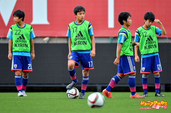BANGKOK, THAILAND - JULY 23: Takefusa Kubo #17 of Japan holds the ball during the friendly match between Thailand U-16 and Japan U-15 at Leo Stadium on July 23, 2015 in Bangkok, Thailand.  (Photo by Thananuwat Srirasant/Getty Images)