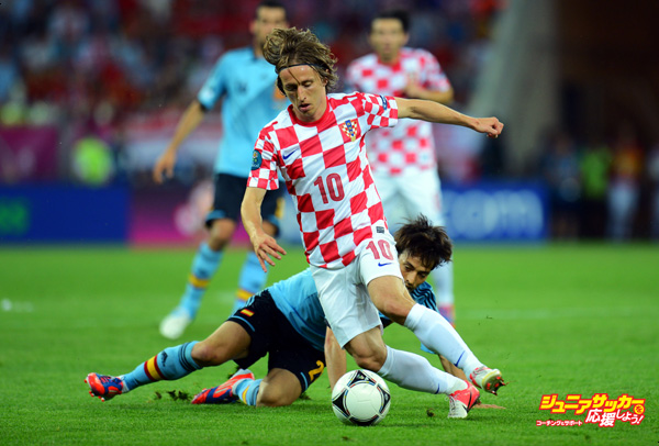 GDANSK, POLAND - JUNE 18: Luka Modric of Croatia gets the better of David Silva of Spain during the UEFA EURO 2012 group C match between Croatia and Spain at The Municipal Stadium on June 18, 2012 in Gdansk, Poland.  (Photo by Shaun Botterill/Getty Images)