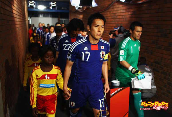 PRETORIA, SOUTH AFRICA - JUNE 29:  Makoto Hasebe of Japan walks down the tunnel ahead of the 2010 FIFA World Cup South Africa Round of Sixteen match between Paraguay and Japan at Loftus Versfeld Stadium on June 29, 2010 in Pretoria, South Africa.  (Photo by Jeff Mitchell - FIFA/FIFA via Getty Images)