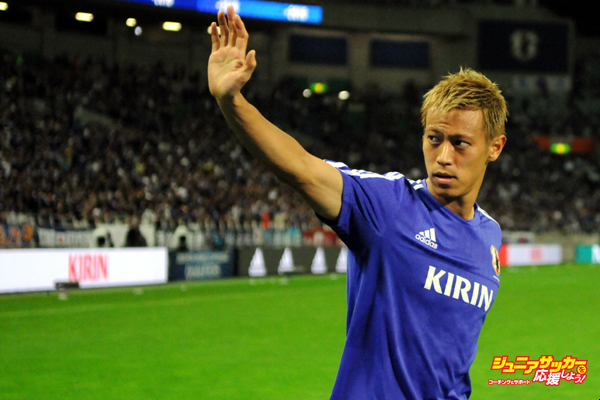 SAITAMA, JAPAN - SEPTEMBER 3: Keisuke Honda of Japan celebrates his team's 3-0 win after the 2018 FIFA World Cup Qualifier Round 2 - Group E match between Japan and Cambodia at Saitama Stadium on September 03, 2015 in Saitama, Japan. (Photo by Hiroki Watanabe/Getty Images)