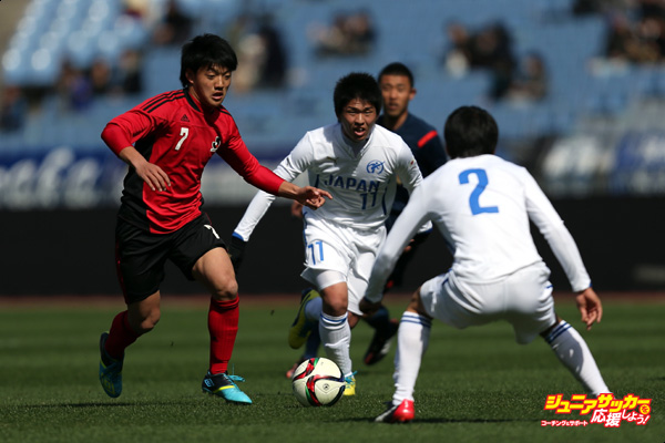YOKOHAMA, JAPAN - FEBRUARY 28:  (Editorial Use Only) Ritsu Doan (L) of U-18 J.League XI in action during the Next Generation Match between U-18 J.League XI and Japan High School XI at Nissan Stadium on February 28, 2015 in Yokohama, Kanagawa, Japan.  (Photo by Kaz Photography/Getty Images)
