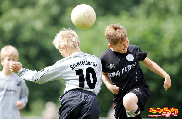 HAMBURG, GERMANY - JUNE 23:  Boys from the 9-11 year old age group go up for a header during the (DFB) German Football Association's E-Youth children's soccer tournament on June 23, 2007 in Hamburg, Germany.  (Photo by Martin Rose/Bongarts/Getty Images)