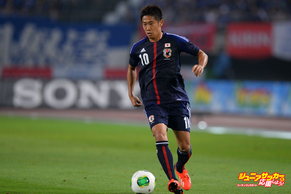 RIFU, JAPAN - AUGUST 14:  Shinji Kagawa of Japan in action during the international friendly match between Japan and Uruguay at Miyagi Stadium on August 14, 2013 in Rifu, Miyagi, Japan.  (Photo by Masterpress/Getty Images)