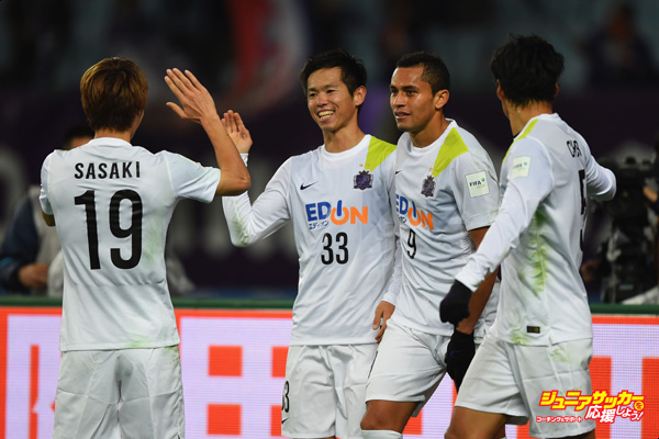 OSAKA, JAPAN - DECEMBER 13:  Tsukasa Shiotani of Sanfrecce Hiroshima celebrates with team-mates after scoring during the the FIFA Club World Cup Quarter Final match between TP Mazembe and Sanfrecce Hiroshima at Osaka Nagai Stadium on December 13, 2015 in Osaka, Japan.  (Photo by Shaun Botterill - FIFA/FIFA via Getty Images)