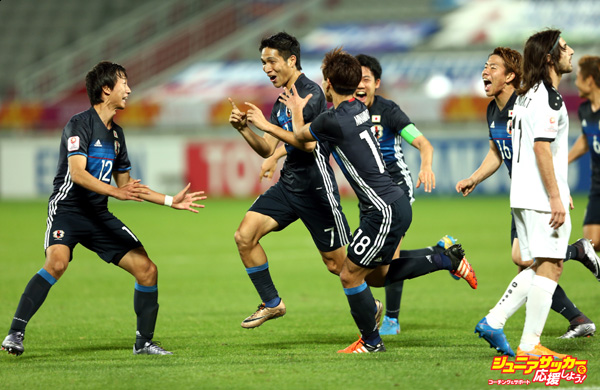 DOHA, QATAR - JANUARY 26:  Riki Harakawa of Japan is congratulated by his team mates after scoring the winning goal during the AFC U-23 Championship semi final match between Japan and Iraq at the Abdullah Bin Khalifa Stadium on January 26, 2016 in Doha, Qatar.  (Photo by Warren Little/Getty Images)