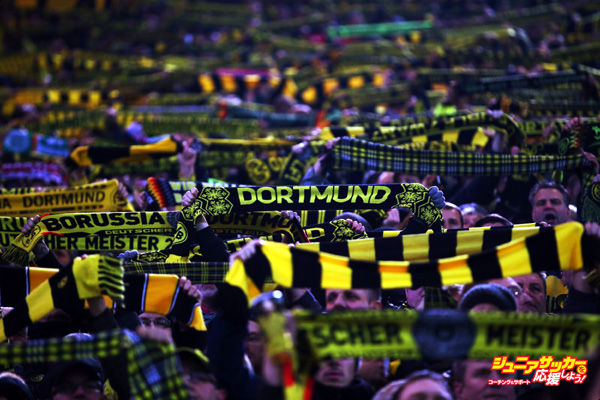 DORTMUND, GERMANY - DECEMBER 05:  Fans of Dortmund hold up their scarfs during the Bundesliga match between Borussia Dortmund and 1899 Hoffenheim at Signal Iduna Park on December 5, 2014 in Dortmund, Germany.  (Photo by Alex Grimm/Bongarts/Getty Images)