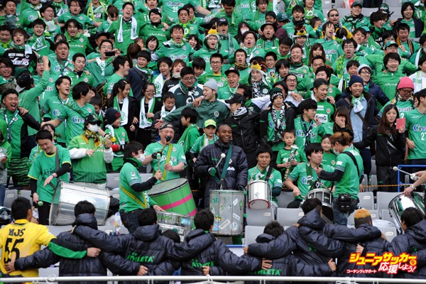 CHOFU, JAPAN - FEBRUARY 28:  (EDITORIAL USE ONLY) Weslley #15 of Tokyo Verdy (center) plays a drum. Players (under) and Supporters celebrate the win after the J.League second division match between Tokyo Verdy and Hokkaido Consadole Sapporo at the Ajinomoto Stadium on February 28, 2016 in Chofu, Tokyo, Japan.  (Photo by Masashi Hara/Getty Images)
