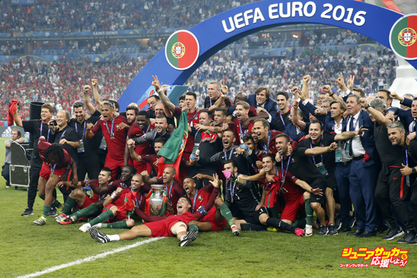 goalkeeper Rui Patricio of Portugal, Bruno Alves of Portugal, Pepe of Portugal, Jose Fonte of Portugal, Raphael Guerreiro of Portugal, Ricardo Carvalho of Portugal, Cristiano Ronaldo of Portugal, Joao Moutinho of Portugal, Eder of Portugal, Joao Mario of Portugal, Vierinha of Portugal, goalkeeper Anthony Lopes of Portugal, Danilo of Portugal, William Carvalho of Portugal, Andre Gomes of Portugal, Renato Sanches of Portugal, Nani of Portugal, Rafa SIlva of Portugal, Eliseu of Portugal, Ricardo Quaresma of Portugal, Cedric of Portugal, goalkeeper Eduardo of Portugal, Adrien Silva of Portugal, coach Fernando Santos of Portugal with Coupe Henri Delaunay during the UEFA EURO 2016 final match between Portugal and France on July 10, 2016 at the Stade de France in Paris, France.(Photo by VI Images via Getty Images)