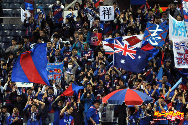 SAITAMA, JAPAN - APRIL 01:  (EDITORIAL USE ONLY) Supporter of Ventforet Kofu waves the national flag of Australia prior to the J.League match between Urawa Red Diamonds and Ventforet Kofu at the Saitama Stadium on April 1, 2016 in Saitama, Japan.  (Photo by Masashi Hara/Getty Images)