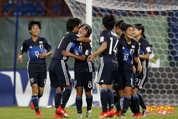 AMMAN, JORDAN - OCTOBER 08:  Hinata Miyazawa (C) of Japan celebrates with team mates after scoring her team's third goal during the FIFA U-17 Women's World Cup Group D match between Japan and USA at Amman International Stadium on October 8, 2016 in Amman, Jordan.  (Photo by Boris Streubel - FIFA/FIFA via Getty Images)