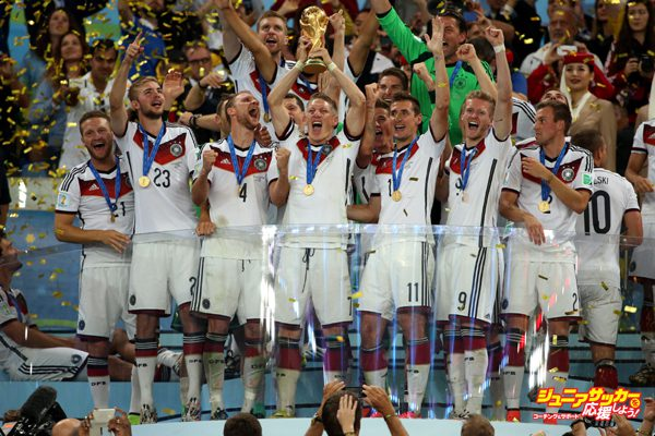 RIO DE JANEIRO, BRAZIL - JULY 13: Bastian Schweinsteiger of Germany holds the trophy and celebrate the victory with his teammates during the trophy presentation after the 2014 FIFA World Cup Brazil Final match between Germany and Argentina at Estadio Maracana on July 13, 2014 in Rio de Janeiro, Brazil. (Photo by Jean Catuffe/Getty Images)