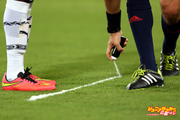 NATAL, BRAZIL - JUNE 16: Referee Jonas Eriksson of Sweden sprays foam to mark the free kick distance during the 2014 FIFA World Cup Brazil Group G match between Ghana and the United States at Estadio das Dunas on June 16, 2014 in Natal, Brazil.  (Photo by Michael Steele/Getty Images)