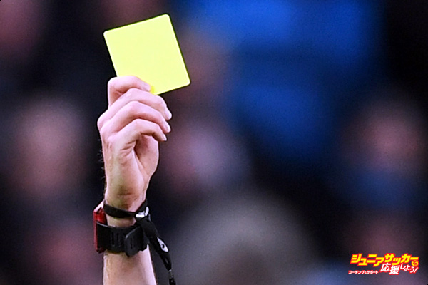 MANCHESTER, ENGLAND - JANUARY 02:  Referee Lee Mason (R) shows Yaya Toure of Manchester City (L) a yellow card during the Premier League match between Manchester City and Burnley at Etihad Stadium on January 2, 2017 in Manchester, England.  (Photo by Shaun Botterill/Getty Images)