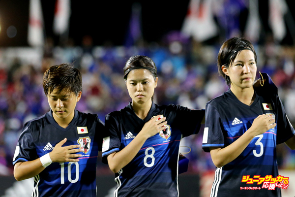 Port Moresby, PNG - NOVEMBER 13: Yuka Momiki #10 of Japan, Yui Hasegawa #8, Hikaru Kitagawa #3, and Narumi Miura #14 stand for the playing of the Japanese National Anthem before their Group B in the FIFA U-20 Women's World Cup Papua New Guinea 2016 against Nigeria on November 13, 2016 at Bava Park in Port Moresby, Papua New Guinea.