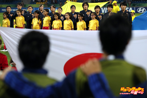 AMMAN, JORDAN - OCTOBER 21:  Japan players sing their national anthem during the FIFA U-17 Women's World Cup Jordan 2016 Final match between Korea DPR and Japan at Amman International Stadium on October 21, 2016 in Amman, Jordan.  (Photo by Christopher Lee - FIFA/FIFA via Getty Images)