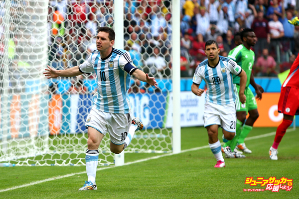 PORTO ALEGRE, BRAZIL - JUNE 25:  Lionel Messi of Argentina celebrates scoring his team's first goal during the 2014 FIFA World Cup Brazil Group F match between Nigeria and Argentina at Estadio Beira-Rio on June 25, 2014 in Porto Alegre, Brazil.  (Photo by Alex Grimm - FIFA/FIFA via Getty Images)