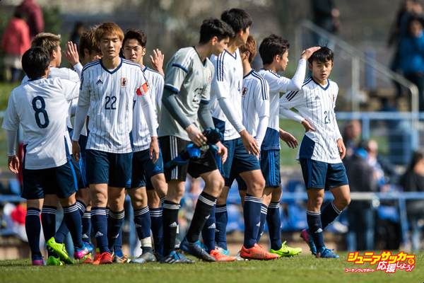 DUISBURG, GERMANY - MARCH 26: Takefusa Kubo (R) of Japan and team mates shake hands after winning a Friendly Match between MSV Duisburg and the U20 Japan on March 26, 2017 in Duisburg, Germany. (Photo by Lukas Schulze/Getty Images)