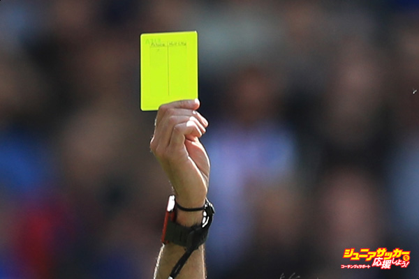 LONDON, ENGLAND - MAY 14: Andrew Robertson of Hull City is shown a yellow card by referee Martin Atkinson during the Premier League match between Crystal Palace and Hull City at Selhurst Park on May 14, 2017 in London, England.  (Photo by Matthew Lewis/Getty Images)