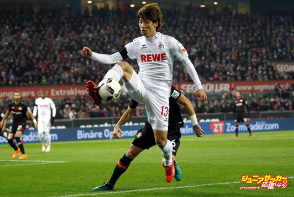 COLOGNE, GERMANY - DECEMBER 21: Yuya Osako (R) of Cologne in action with Aleksandar Dragovic of Leverkusen during the Bundesliga soccer match between 1. FC Cologne and Bayer Leverkusen at the Rhein-Energie stadium in Cologne, Germany on December 21, 2016.  (Photo by Ina Fassbender/Anadolu Agency/Getty Images)