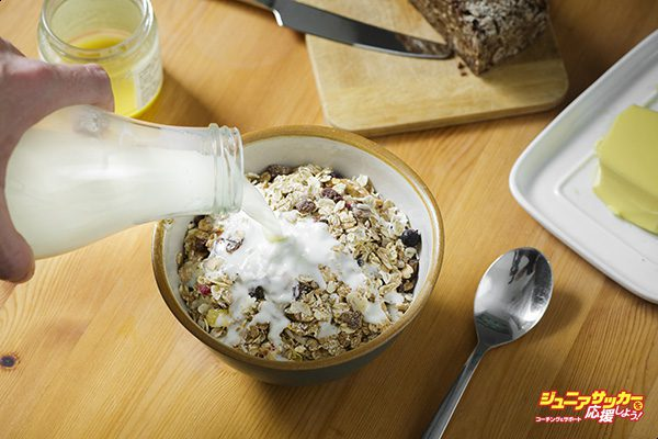 Berlin, Germany - October 24: Muesli in a bowl is doused with milk from a bottle on October 24, 2015 in Berlin, Germany. (Photo by Thomas Trutschel/Photothek via Getty Images)