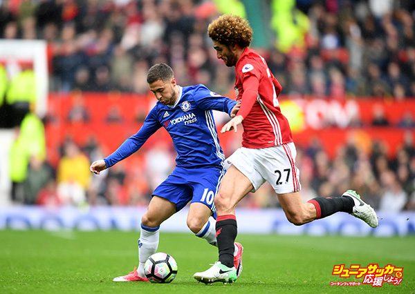 MANCHESTER, ENGLAND - APRIL 16: Eden Hazard of Chelsea attempts to take the ball past Marouane Fellaini of Manchester United during the Premier League match between Manchester United and Chelsea at Old Trafford on April 16, 2017 in Manchester, England.  (Photo by Michael Regan/Getty Images)