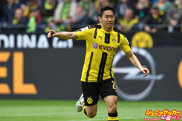 DORTMUND, GERMANY - APRIL 15: Shinji Kagawa of Borussia Dortmund celebrates his team's first goal scored by Marco Reus (not pictured) during the Bundesliga match between Borussia Dortmund and Eintracht Frankfurt at Signal Iduna Park on April 15, 2017 in Dortmund, Germany. (Photo by Etsuo Hara/Getty Images)