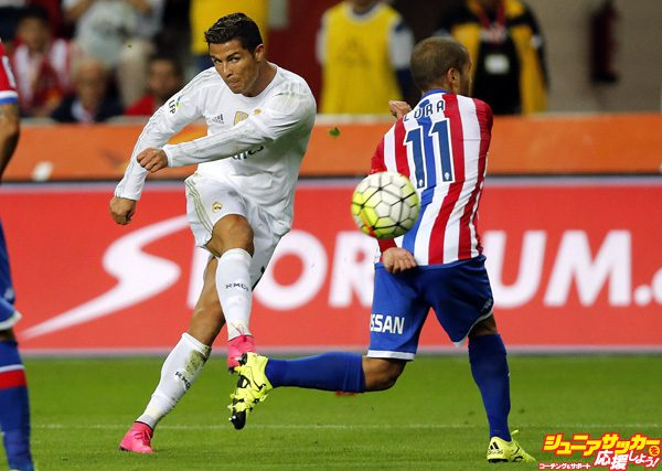 GIJON, SPAIN - AUGUST 23: Cristiano Ronaldo of Real Madrid shoots on goal past Alberto Lora of Sporting Gijon during the La Liga match between Sporting Gijon and Real Madrid CF at Estadio El Molinon on August 23, 2015 in Gijon, Spain. (Photo by Angel Martinez/Real Madrid via Getty Images)