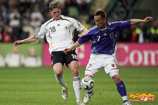 LEVERKUSEN, GERMANY - MAY 30: Tim Borowski of Germany in action with Hidetoshi Nakata of Japan during the international friendly match between Germany and Japan at the BayArena on May 30, 2006 in Leverkusen, Germany.  (Photo by Lars Baron/Bongarts/Getty Images)