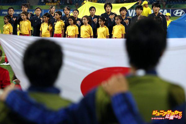 AMMAN, JORDAN - OCTOBER 21:  Japan players sing their national anthem during the FIFA U-17 Women's World Cup Jordan 2016 Final match between Korea DPR and Japan at Amman International Stadium on October 21, 2016 in Amman, Jordan.  (Photo by Christopher Lee - FIFA/FIFA via Getty Images)