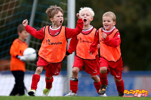 DINSLAKEN, GERMANY - OCTOBER 01: A young boy celebrates after scoring a goal during a football bambini tournament of SUS Dinslaken 09 on Oktober 1, 2016 in Dinslaken, Germany. Sport is an important way for children to explore and develop lifelong skills. In recent years critical reports warn that children do not get enough exercise and instead spend too much time with their playstations, tablets and smartphones. With his project, sports photographer and a father of two Lars Baron, looks at the current situation of youth sport in Germany. Over the course of a year he documented children during various sports competitions, including football, swimming, gymnastics, ice hockey and motocross. (Photo by Lars Baron/Bongarts/Getty Images)