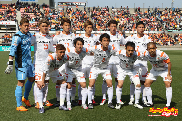 SHIZUOKA, JAPAN - FEBRUARY 28:  (EDITORIAL USE ONLY) Ehime FC players line up for the team photos prior to the J.League second division match between Shimizu S-Pulse and Ehime FC at the IAI Stadium Nihondaira on February 28, 2016 in Shizuoka, Japan.  (Photo by Kaz Photography/Getty Images)