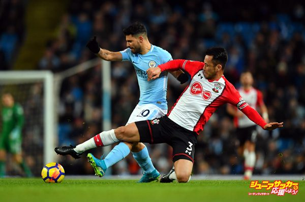 MANCHESTER, ENGLAND - NOVEMBER 29: Sergio Aguero of Manchester City is challenged by Maya Yoshida of Southampton during the Premier League match between Manchester City and Southampton at Etihad Stadium on November 29, 2017 in Manchester, England.  (Photo by Dan Mullan/Getty Images)