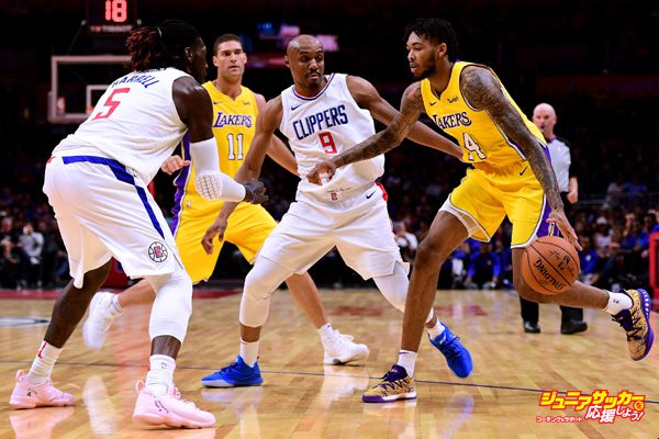 LOS ANGELES, CA - OCTOBER 13:  Brandon Ingram #14 of the Los Angeles Lakers attempts a pick and roll with Brook Lopez #11 as he is defenede by C.J. Williams #9 and Montrezl Harrell #5 of the LA Clippers during the first half at Staples Center on October 10, 2017 in Los Angeles, California.  (Photo by Harry How/Getty Images)
