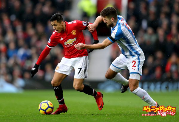 MANCHESTER, ENGLAND - FEBRUARY 03:  Tommy Smith of Huddersfield Town chases down Alexis Sanchez of Manchester United during the Premier League match between Manchester United and Huddersfield Town at Old Trafford on February 3, 2018 in Manchester, England.  (Photo by Mark Thompson/Getty Images)