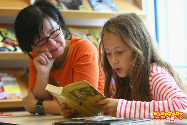 BERLIN - SEPTEMBER 18:  A fourth-grade student reads a book with her teacher in the elementary school at the John F. Kennedy Schule dual-language public school on September 18, 2008 in Berlin, Germany. The German government will host a summit on education in Germany scheduled for mid-October in Dresden. Germany has consistantly fallen behind in recent years in comparison to other European countries in the Pisa education surveys, and Education Minister Annette Schavan is pushing for an 8 percent increase in the national educaiton budget for 2009.  (Photo by Sean Gallup/Getty Images)