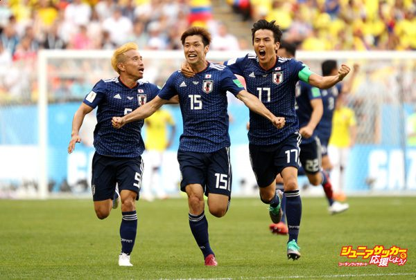 SARANSK, RUSSIA - JUNE 19:  Yuya Osako of Japan celebrates scoring the 2nd Japan goal to make it 2-1 with Yuto Nagatomo and Makoto Hasebe of Japan during the 2018 FIFA World Cup Russia group H match between Colombia and Japan at Mordovia Arena on June 19, 2018 in Saransk, Russia.  (Photo by Adam Pretty - FIFA/FIFA via Getty Images)