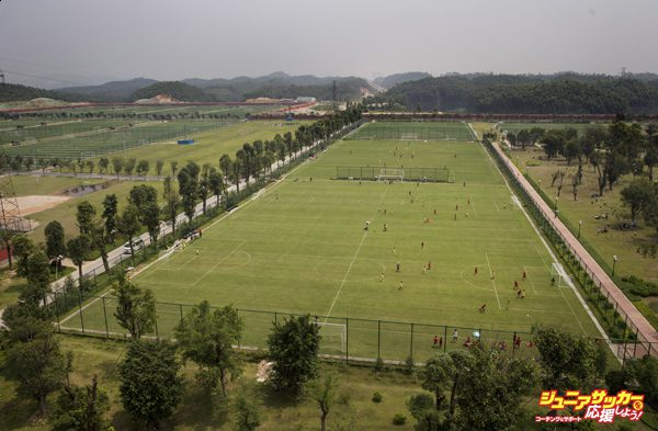 QINGYUAN, CHINA - JUNE 14:  A view of some of the 50 pitches at the  at the Evergrande International Football School on June 14, 2014 near Qingyuan in Guangdong Province, China. The sprawling 167-acre campus is the brainchild of property tycoon Xu Jiayin, whose ambition is to train a generation of young athletes to establish China as a football powerhouse. The school is considered the largest football academy in the world with 2400 students, more than 50 pitches and a squad of Spanish coaches through a partnership with Real Madrid. (Photo by Kevin Frayer/Getty Images)