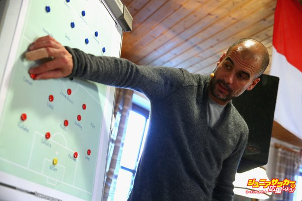 VILSBIBURG, GERMANY - NOVEMBER 29:  Joseph Guardiola, head coach of FC Bayern Muenchen shows tactical moves on a tactics board during his  visit to the FC Bayern Muenchen supporter club `Bavarian Bazis Vilsbiburg`at Gasthaus Breitenbacher on November 29, 2015 in Vilsbiburg, Germany.  (Photo by Alexander Hassenstein/Bongarts/Getty Images)