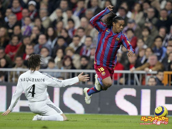 MADRID, SPAIN - NOVEMBER 19: Ronaldinho (R) of Barcelona gets past Sergio Ramos of Real Madrid  during a Primera Liga match between Real Madrid and F.C. Barcelona at the Bernabeu on November 19, 2005 in Madrid, Spain.(Photo by Denis Doyle/Getty Images)