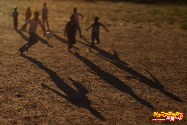 GEORGE, SOUTH AFRICA - JUNE 25:  (EDITORS NOTE: A TILT AND SHIFT LENS WAS USED IN THE CREATION OF THIS IMAGE) The shadow of children playing football are seen at the Lawaaikamp Sport ground at a Japan football team township visit during the FIFA 2010 World Cup on June 25, 2010 in George, South Africa.  (Photo by Mark Kolbe/Getty Images)