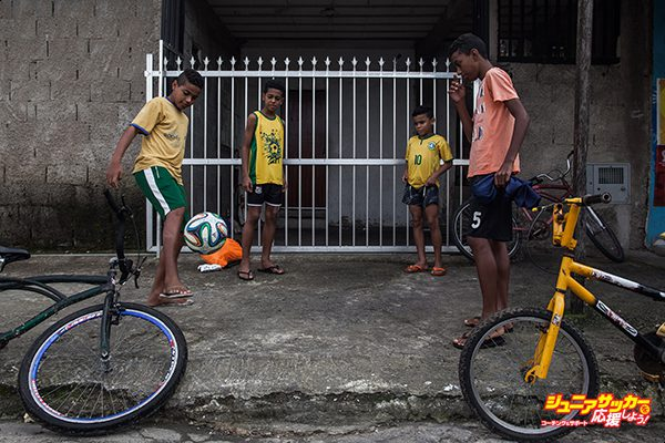 PRAIA GRANDE, BRAZIL - JUNE 17:  Boys play soccer in the streets of the Garden Gloria neighborhood on June 17, 2014 in Praia Grande, Brazil.  Soccer star Neymar of Brazil lived in this neighborhood between 7 and 12 years of age and is building a sports and educational center for the neighborhood kids. (Photo by Victor Moriyama/Getty Images)